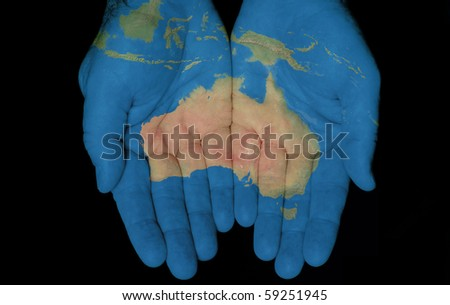 Map painted on hands showing concept of having the Country Of Australia in our hands - stock photo