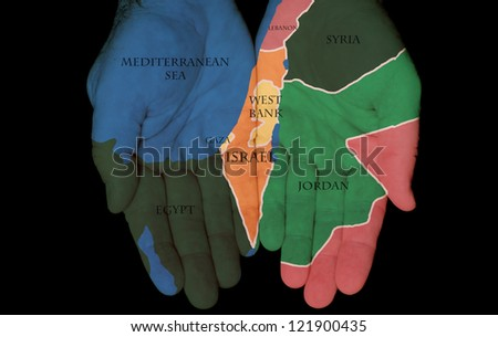 Map Painted On Hands Showing The Concept Of Israel and Palestine In The Hands Of The People