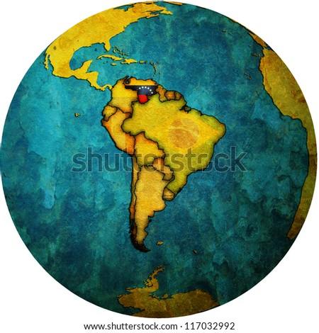map with flag of venezuela on isolated over white map of globe - stock photo