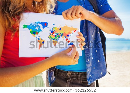 map with travel destinations pinned - stock photo