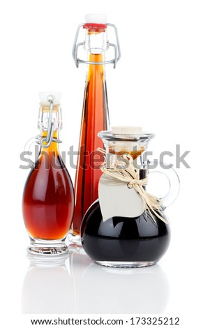 maple syrup in glass bottle or herbal syrup, ardent drink, mixture, with heart label. on white background. - stock photo