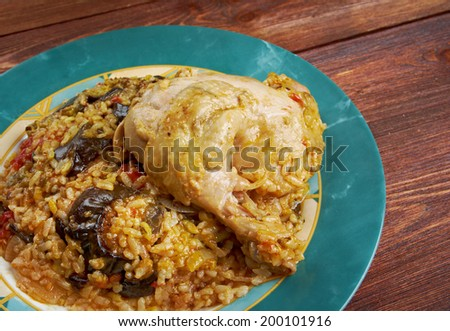 """Maqluba  is a traditional dish of the Arab Levant, Persia, and Palestine.dish includes meat, rice, when served, hence the name maqluba, which translates literally as """"upside-down"""". - stock photo"""