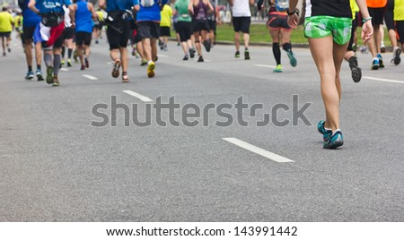 Marathon runner ends up walking for a bit. - stock photo