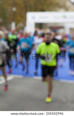 Marathon runners, blur and motion effect, unrecognizable persons and logos