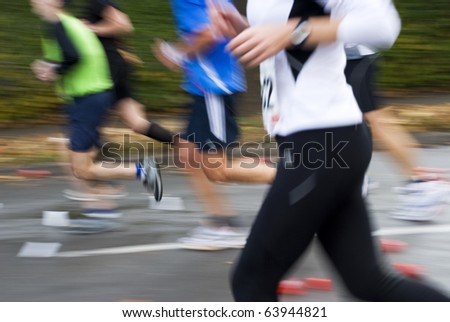 Marathon runners close up - stock photo