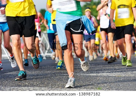 Marathon running race people competing in fitness and healthy active lifestyle feet on road - stock photo