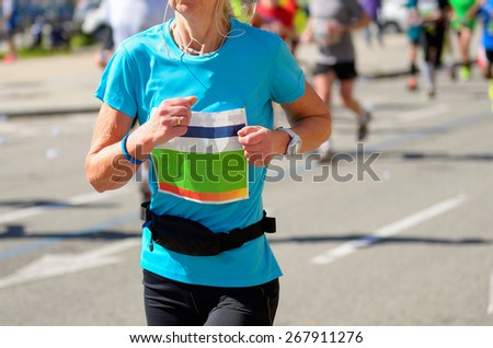 Marathon running race, woman runner on road, sport, fitness and healthy lifestyle concept  - stock photo