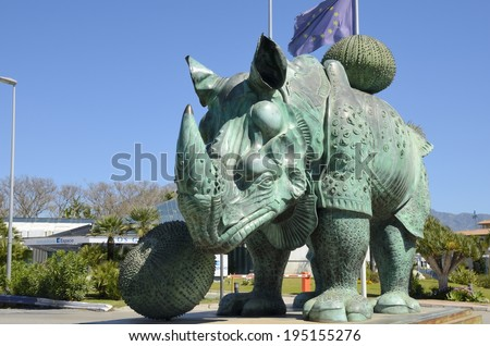 """MARBELLA, SPAIN - APRIL 6:  Sculpture named """"Rhinoceros dressed in lace"""" of Dali on April 6, 2014 Marbella, Spain. This sculpture is locate in Puerto Banus, a marina of Marbella.  - stock photo"""