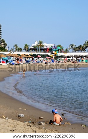 MARBELLA, SPAIN - SEPTEMBER 26, 2009 - Holidaymakers on the beach, Marbella, Costa del Sol, Malaga Province, Andalucia, Spain, Western Europe. - stock photo