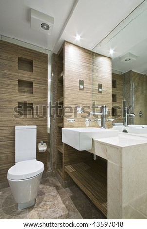 Marble bathroom with mosaic tiles and wooden walls
