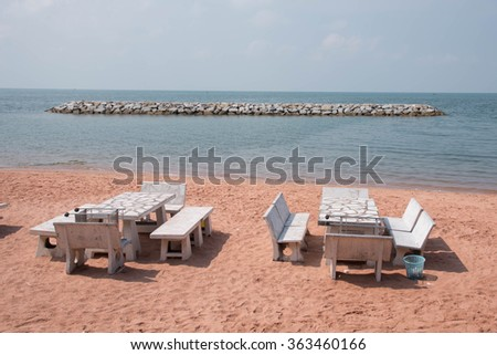 Marble bench on the seaside coast with blue sky - stock photo