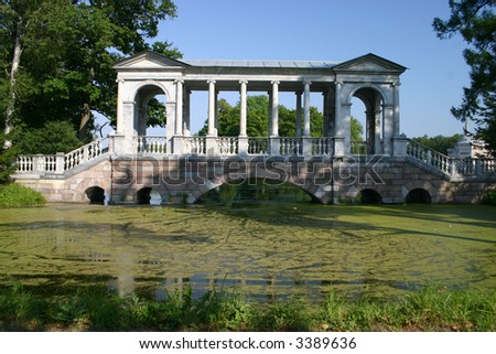 Marble Bridge in Catherine park. Tsarskoye Selo  is a former Russian residence of the imperial family and visiting nobility 24 km south from the center of St. Petersburg. - stock photo