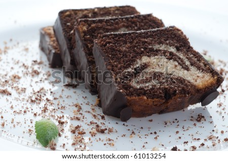 Marble cake on  plate with sauce and flower