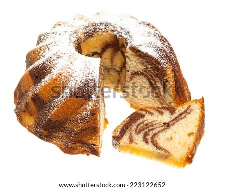 Marble cake with single slice isolated on white background - stock photo