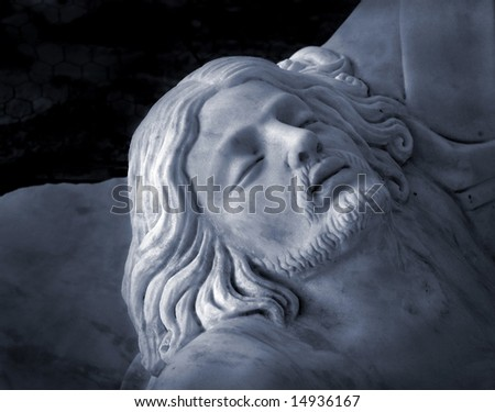 Marble carved statue of Jesus face after crucifixion. - stock photo
