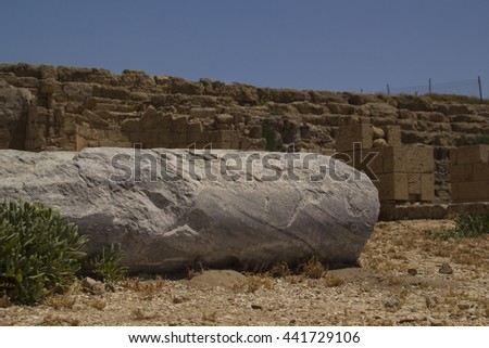Marble column ruin in Caesarea - a city and harbor built by Herod the Great about 25-13 BC. Today, its ruins lie on the Mediterranean coast of Israel