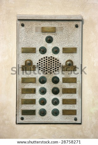 Marble doorbells plate with brass name plates - stock photo