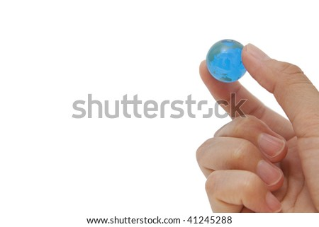Marble earth and hand - stock photo