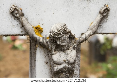 Marble figure detail of Christ on the cross for aging time in a cemetery  - stock photo