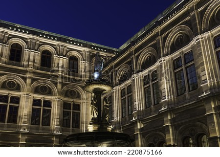 Marble fountain depicting Music with allegorical figures outside the Vienna Opera House in Vienna at night, Austria. - stock photo