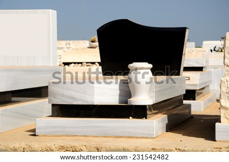 Marble gravestone at jewish cemetery in the central Israel. - stock photo