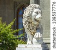 Marble sculpture of lion with ball in Vorontsov Palace in the town of Alupka, Crimea, Ukraine. - stock photo