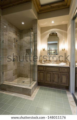Marble shower cubicle with tiled green floor - stock photo