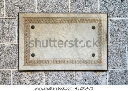 marble signboard on the old stone wall. with clipping path. - stock photo