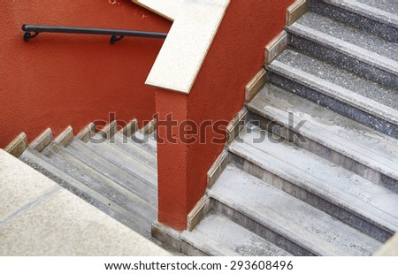 Marble staircase with red walls. View from above - stock photo