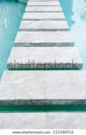marble steps on pool - stock photo