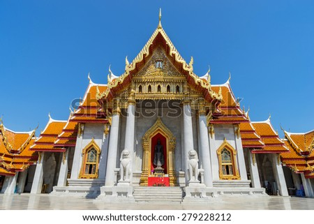 Marble temple is landmark of Bangkok, Thailand, under blue sky