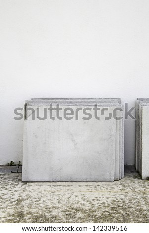 Marble tombstones on cemetery wall, reconstruction and construction - stock photo