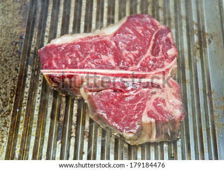marbled meat on the grill - stock photo