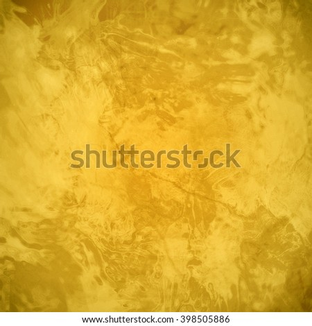 marbled textured background, glossy glass pattern of wavy texture shapes, gold background or yellow color - stock photo