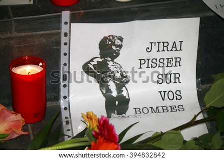 "MARCH 22, 2016 - BERLIN: ""J'irai pisser sur vos bombes"" (I will piss on your bombes) - mounring in front of the Belgian Embassy after the lisamistic terror attacks in Brussels. - stock photo"
