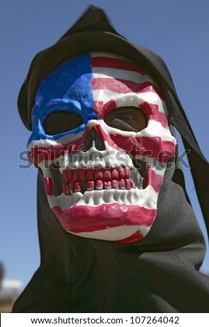 MARCH 2005 - Death mask with an American flag of the grim reaper at George W. Bush and anti-America protest in Tucson, AZ - stock photo