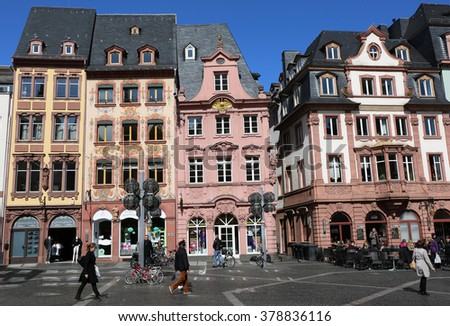 MARCH 30-MAINZ,GERMANY:People walking by the Old Historic buildings  at the Market place.March 30,2015 in Mainz,Germany.