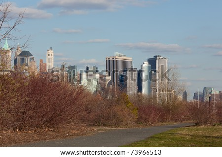 March 2011. Manhattan, lower New York financial offices(downtown) over Hudson river panorama from Liberty State Park(Jersey city). One World Trade Center building under construction