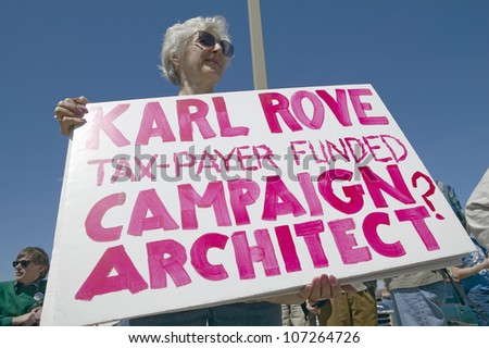 MARCH 2005 - Picture of anti-Bush political rally in Tucson, AZ with signs about Karl Rove in Tucson, AZ - stock photo