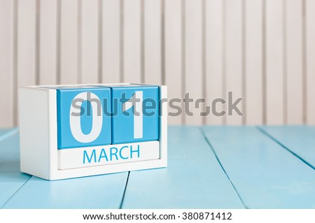 March 1st. Image of march 1 wooden color calendar on white background.  First spring day, empty space for text - stock photo