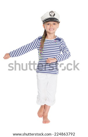 Marching mischievous girl in costume cabin boy. Girl is six years old. On her cap emblem of Russia.  - stock photo