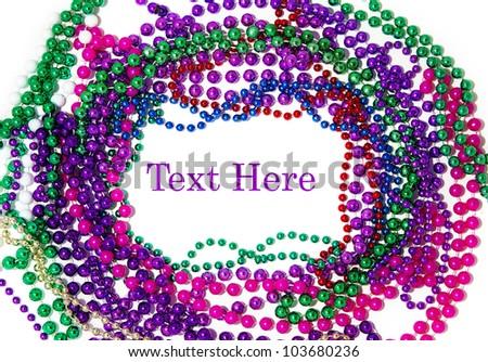 Mardi gras bead border on white background - stock photo
