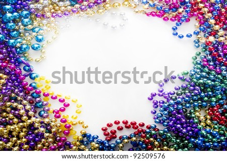 mardi gras beads for decoration - stock photo