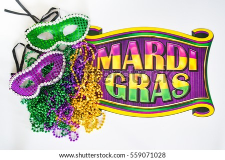 Mardi gras beads masks banner reading stock photo safe to use mardi gras beads masks and banner reading mardi gras in traditional festive colors on a m4hsunfo