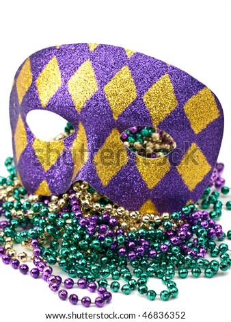 Mardi Gras mask and beads on white - stock photo