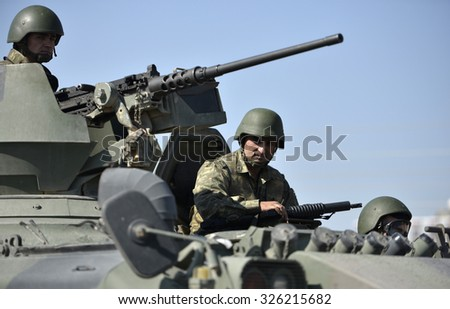 MARDN,TURKEY, 9 OCTOBER 2015 Soldiers of Turkish military patrol with tanks at Kiziltepe district in Mardin.  - stock photo