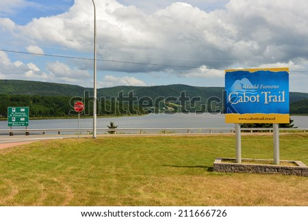 MARGAREE HARBOUR, CANADA - JUL 30, 2014:  Sign for world famous Cabot Trail in Cape Breton, NS shows two different options of travelling around the trail which loops around the northern part of island - stock photo