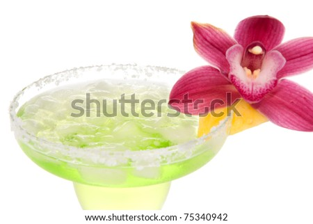 Margarita cocktail drink vertical close up composition with pink orchid flower and pineapple decoration. Focus on ice inside glass - stock photo