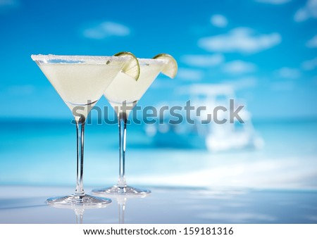 margarita  cocktail on beach, blue sea and sky background - stock photo
