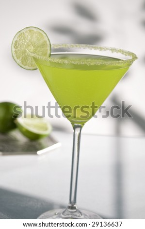 margarita drink with lime, focus is on rim of glass, and salt